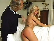 Buxom blonde with big sexy ass bends over the sofa and spreads her cheeks for the cane