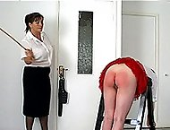 Caned on her sore red bottom with little red panties at half mast - searing strokes