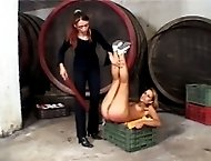 Gorgeous girl stripped naked in the wine cellar and strapped on her beautiful bare bottom