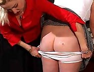 Icy Headmistress canes her captives thick ass